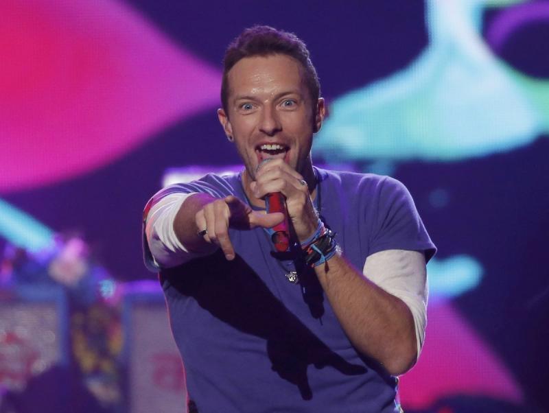 Chris Martin, cantant del grup, actuant en una entrega de premis el novembre a Los Angeles Foto:REUTERS